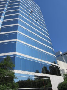 Cox Automotive team members rappel down 22-story building