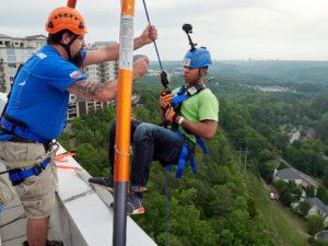 Cox Automotive team member rappel down a 22-story building